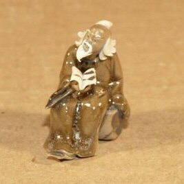 "Man Reading Book Figurine 1 1/2"" glazed ceramic figurine"