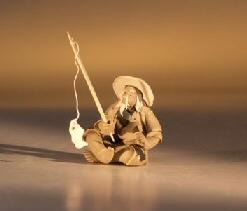 Image: Ceramic  Figurine - Mudman Fisherman 1.25x1.25x1.75