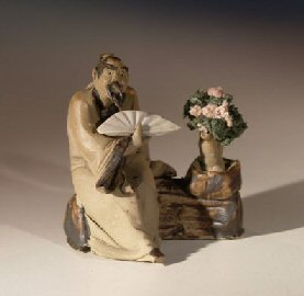 Man Holding Fan with Bonsai Tree Miniature Ceramic Mud Figurine