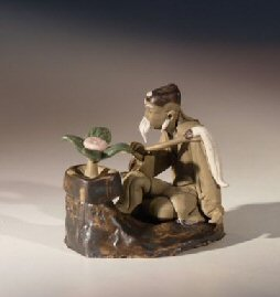 Man Sitting on a Rock with Bonsai Tree Miniature Ceramic Mud Figurine