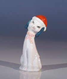 Ceramic Dog Figurine with Red Hat and Black Ears