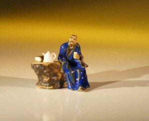 Ceramic Figurine - Man Sitting at Table
