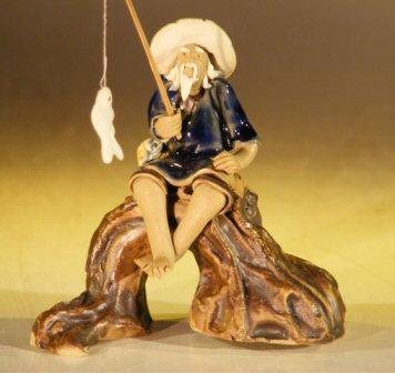 Image: Miniature Ceramic Fisherman Figurine Fisherman Sitting On A Log - Blue Color