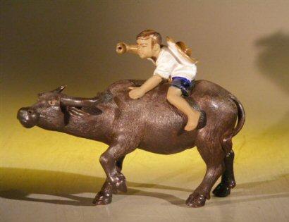 Miniature Ceramic Figurine Boy Riding Buffalo