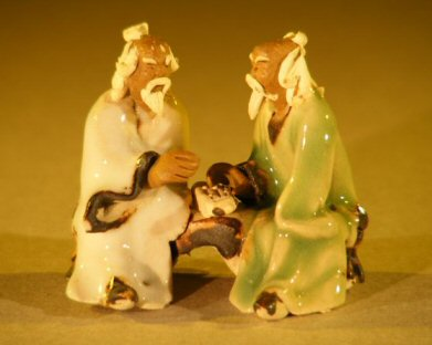 Image: Miniature Ceramic Figurine Two Men Sitting at a Table with Fine Detail Color: White & Green
