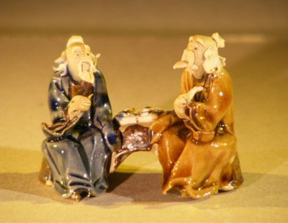 Image: Miniature Ceramic Figurine Two Men Sitting at a Table with Fine Detail  Color: Blue & Brown