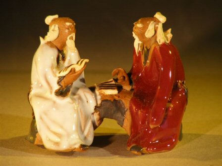 Image: Miniature Glazed Figurine Two Men Sitting on a Bench in Fine Detail