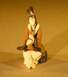 Image: Female Musician Mud Figurine Playing Wind Instrument