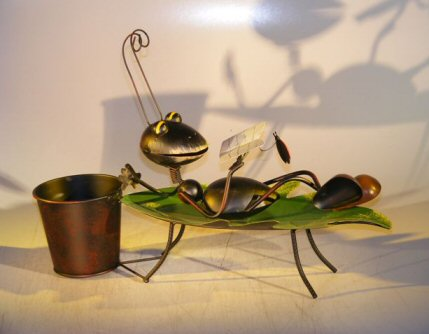 Image: Metal Ant Garden Pot Decoration with Movable Head and Attached Pot Holder 17.0 x 5.0 x 12.0 Tall