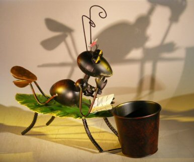 Image: Metal Ant Garden Pot Decoration with Movable Head and Attached Pot Holder 16.0 x 5.0 x 14.0 Tall
