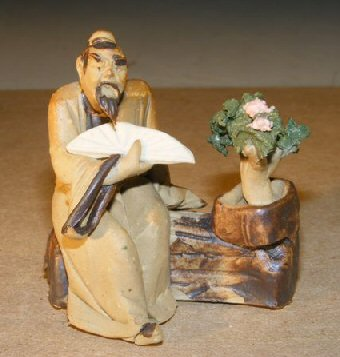 Ceramic Figurine: Man with Bonsai Tree Holding a Fan Measures 2.0 x 2.5 Tall