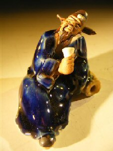 Image: Ceramic Miniature Figurine Man Holding Drinking Cup