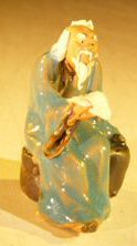 Image: Ceramic Miniature Figurine Man Holding Drinking Cup Fine Detail
