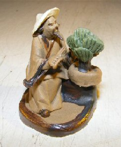 Man Trimming Bonsai Tree Ceramic Mud Figurine