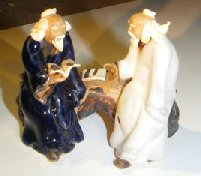Miniature Glazed Figurine Two Men Sitting on a Bench Reading Books Color: Blue & White