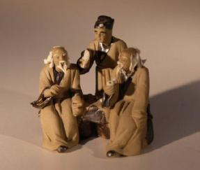 Unglazed Miniature Mud Figurine<br>Three Men Sitting at Chess Table