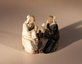 Miniature Glazed Figurine<br>Two Men Sitting at Table