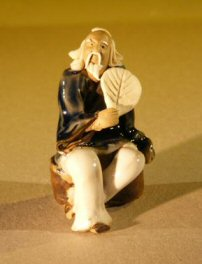 Miniature Figurine: Man Holding a Fan Sitting on a Rock - Blue Color - Fine Detail