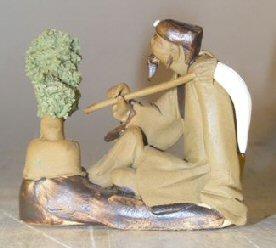 Ceramic Figurine: Man with Bonsai Tree Holding a Brush