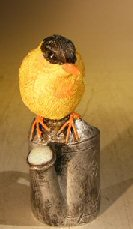 Miniature Bird Figurine<br><i></i>Sitting Atop A Watering Can<br>