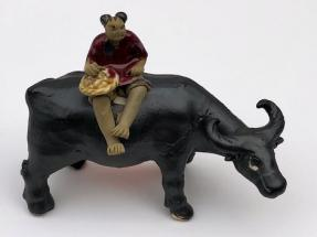Ceramic Figurine<br>Boy Sitting On Standing Buffalo