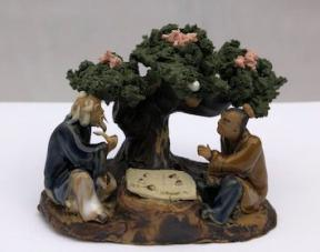 Ceramic Figurine<br>Two Men Playing Board Game Under A Tree