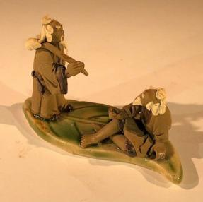 Miniature Ceramic Figurine <br>Two Mud Men On A Leaf, One Standing Holding a Bag, The Other Sitting - 2