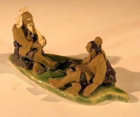 Miniature Ceramic Figurine <br>Two Mud Men On A Leaf, One Sitting Smoking a pipe, The Other Sitting - 2