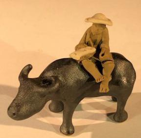 Ceramic Figurine<br>Man Sitting On Standing Buffalo<br> Small