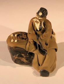 Ceramic Figurine<br> Mud Man Sitting On A Bench Playing Chess - 2.5