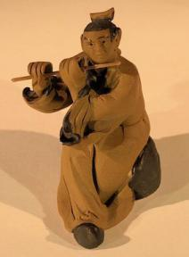 Ceramic Figurine<br> Mud Man Playing Flute - 2.5