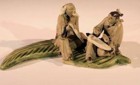 Miniature Ceramic Figurine <br>Two Mud Men On A Leaf, One Sitting Holding a Fan, The Other Sitting With Musical Instrument- 2