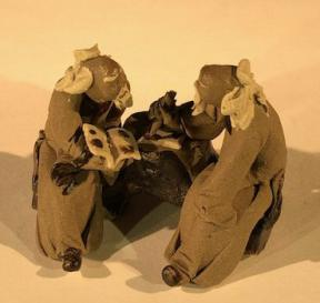 Miniature Ceramic Figurine<br>Two Mud Men Sitting On A Bench Reading Book and Scribing - 1.5
